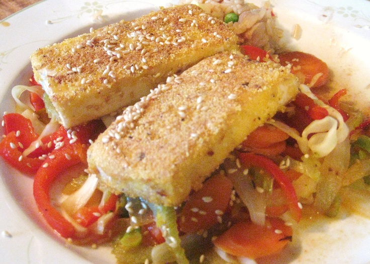 Crispy tofu over stir fried veggies, sprinkled with toasted sesame ...