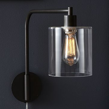 """Lens Sconce ~ CoOL! ~ """"Touch of glass. Inspired by factory lighting, the industrial feel of the glass-and-steel Lens Sconce plays well with warm wooden furniture. Use it as a sofa-side or bedside reading lamp or to illuminate artwork and hallways."""""""