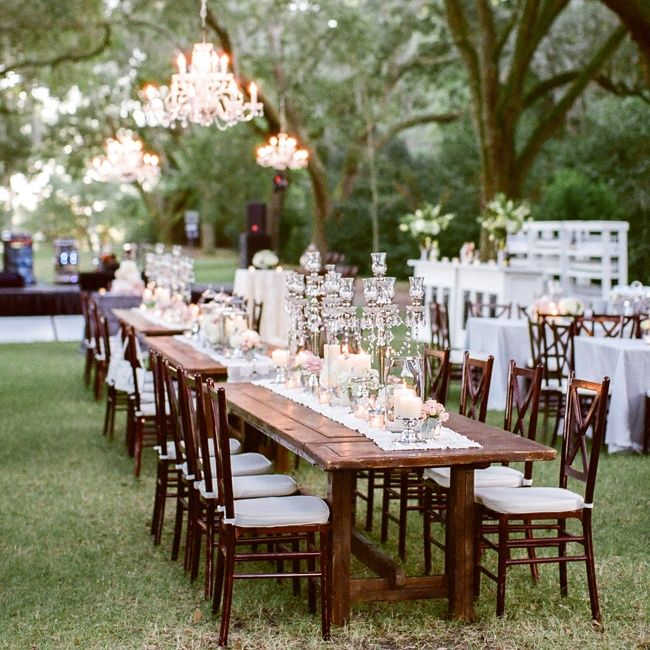 Chic candelabras and white tablecloths with the natural outdoor scenery | Studio 1250 | TheKnot.com