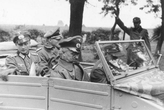 Walter Model im Kübelwagen: Germany, 16 October 1944. Generalfeldmarschall Model visits the headquarters of the 246 volksgrenadier division near Aachen.