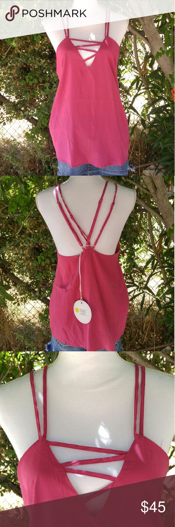"""Bright pink strappy top Perfect for summer! Very trendy with the strappy back and criss cross front. Be a star in this top! The size is a US 6, I wear a M/L and it fit me. So it could fit a medium The mannequin measurements are:  Shoulders: 15"""" Chest: 34"""" Waist: 26.7"""" Hip: 35.4"""" Use #bishoujo to sort for your size  Please note I have several pets, but all items will be washed and cleaned #premonition #strappyblouse #pink #brightpink #pinkstrappyblouse #strappy #nwt Premonition Tops Tank Tops"""