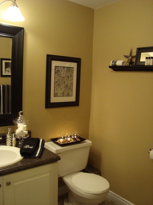 "Basement Bathroom ""Mini Makeover"". Quincy Tan HC-25 by Benjamin Moore. Mirror image of my powder room, which would need: painted cabinet, switch out counter and faucet and light. Add art, shelves and paint a darker color. Doable, cost effective."