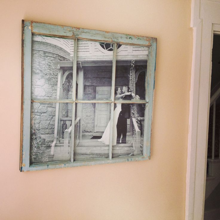$10 antique flea market widow pane and a $4 black and white engineer print from staples... Staple gun the print to the back of the window and hang wires, easy living room wall art. Easiest Pinterest project I've ever done!