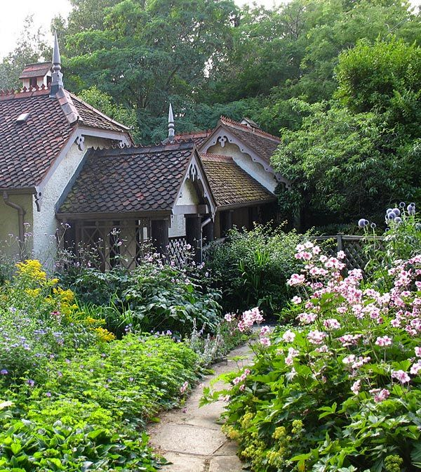 Diminutive cottage nestled in a Russian garden.