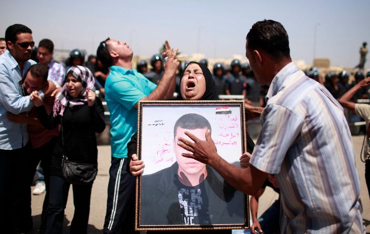 2013 Relatives of people who died during Egypt's revolution react after a court sentenced President Hosni Mubarak to life in prison in June.