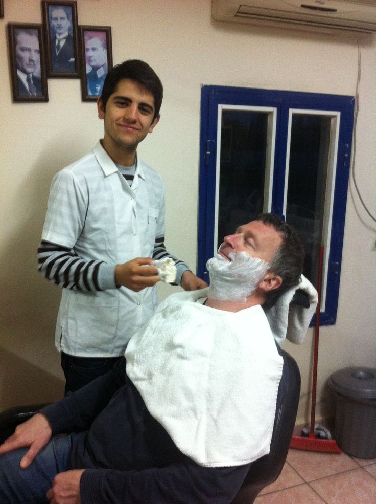 Shaving the old fashion Way. Barber just below were we live: )