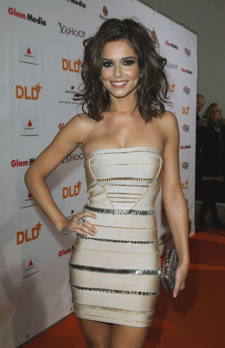 Cheryl sporting a typical Emma dress here love the chic design and volume-us hair here.