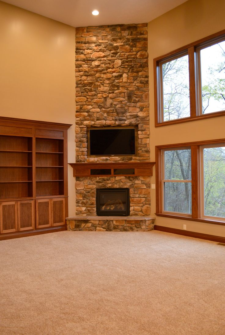 Floor to ceiling corner stone fireplace
