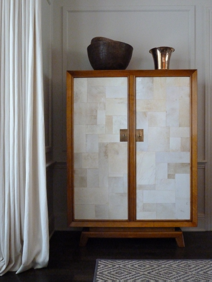 Vintage 1940's French armoire with vellum paneled doors. In the dining room of a Minneapolis project. From Flair in NYC.
