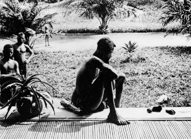 """""""I can not imagine what this man is thinking"""" (Image from Congo Free State under Leopold II ,1905- A father stares at the hands of his five year-old daughter, which were severed as a punishment for having harvested too little caoutchouc/rubber)"""