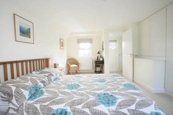 This bedroom has a light, spacious feel thanks to its clever interior design.