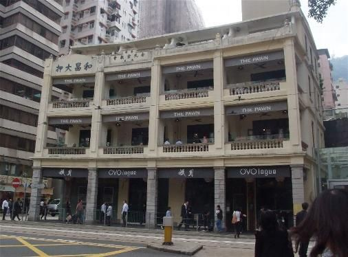 "Guangzhou Verandah Type Shophouse now known as ""The Pawn"" and splendidly restored to its original outlook. Built early 20th century with deep verandah in response to the tropical climate. Now houses restaurants."