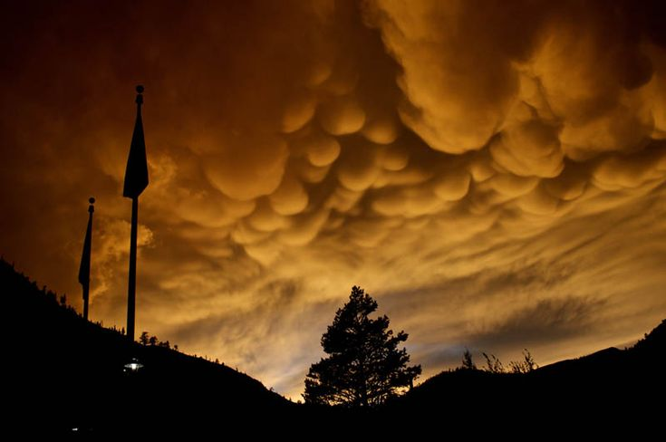 """Mammatus, also known as mammatocumulus (meaning """"mammary cloud"""" or """"breast cloud""""), is a meteorological term applied to a cellular pattern of pouches hanging underneath the base of a cloud. Derived from the Latin mamma (meaning """"breast"""")."""