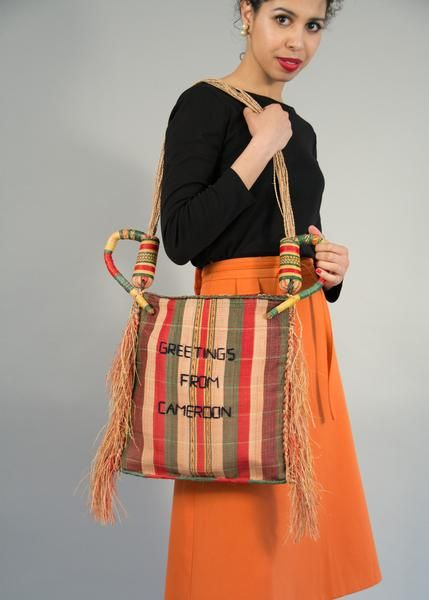 Vintage tribal African straw market bag with fringe and oversize woven handles handmade souvenir of Cameroon