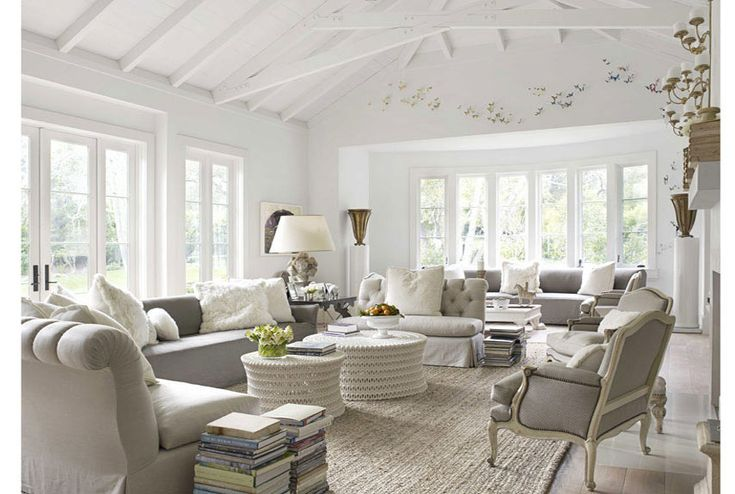 so calming. love the furniture and the separate sitting area in the bay window. love the ottomans!