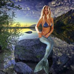 Mermaid sitting on rock by mplumb