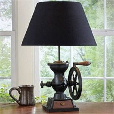 Coffee Grinder Lamp with Shade. Reproduced from a late 19th century black cast iron coffee grinder with wheel. Features the same wooden base, working drawer and wheel handle as the original costly and