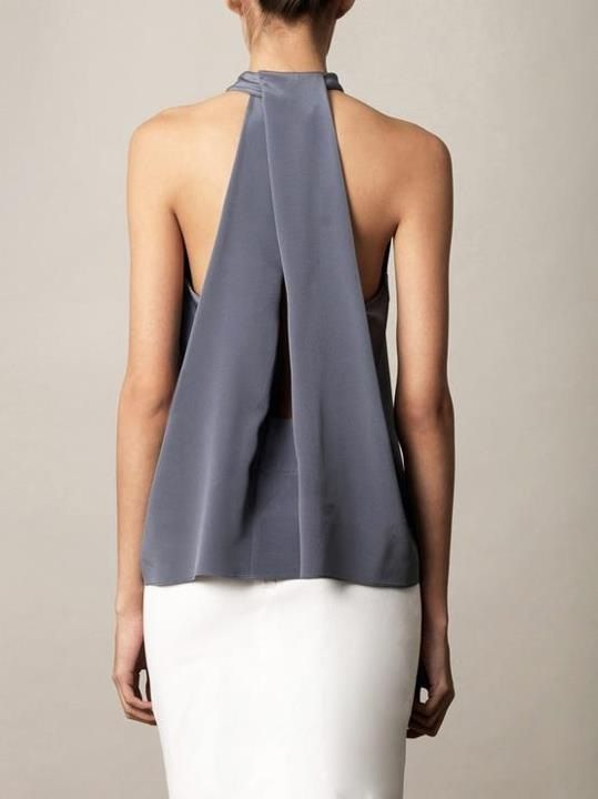 The design of this is a simple drape yet its so elegant and clean. The fabric is folded over at the top and creates some sort of dart that doesn't get sewn down. It works best with flowy fabrics as the desired silhouette is aimed at loose and flowing.