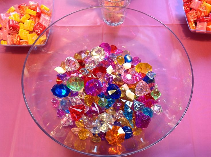 "My Little Pony party game: Rarity jewel search. We hid these ""jewels"" outside like an egg hunt and gave them each a little organza pouch to collect them in. I didn't get any good photos of them searching outside, but it was a hugely popular game and made for some very happy ponies!"