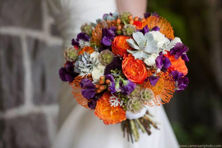 Sophisticated floral designs portland oregon bouquet by www.sophisticatedfloral.com  purple and orange wedding flowers bouquet  succulents, roses, sweet peas, scabiosa pods, hypericum,ranunculus, berzelia, trachilium, hypericum, dusty miller, pincushion protea, jubilee crown leucadendron