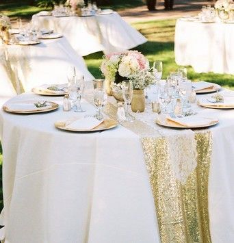 We can't stop thinking about this wedding decoration! They used gold plate charger, painted gold mason jar with beautiful flower arrangement and accentuated their table with a sequin table runner. We are so in love with these wedding decoration ideas