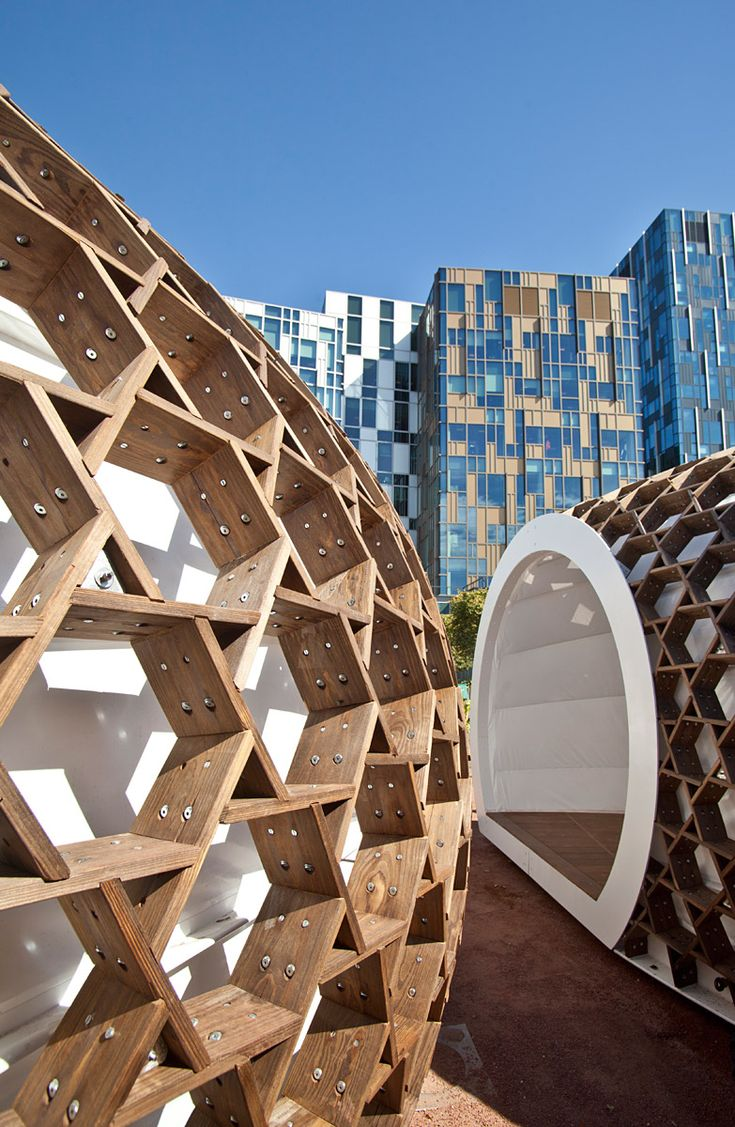 KREOD, a portable wooden structure revealed in London last September, has recently been recognized with a Surface Design Award for Temporary Structure. Designed by Pavilion Architecture, KREOD is constructed of Kebony, a sustainable alternative to tropical hardwood and preservative treated wood.  The venue sculpture currently forms the centerpiece of Peninsula Square, London's busy public space between the Emirates Air Line and The O2 Arena on Greenwich Peninsula.