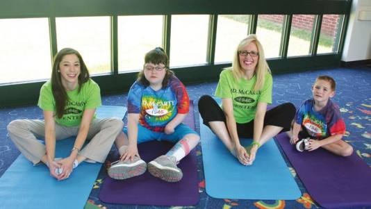 """""""Yoga is the ideal activity for children of all ages and abilities."""" Its non-competitive nature fosters a peaceful, comfortable environment. And for children with developmental disorders, simply learning the calming power of the breath is paramount: The breathing techniques help many of the patients—especially those with a lot of anxiety—calm down and become less stressed."""""""