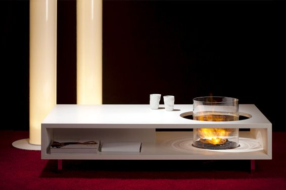 A coffee table created at Planika Studio. Yes, you can use this coffee table as a functional piece of furniture. Yes, you can enjoy real smokeless fire while drinking your favourite blend. And, yes, those moments will be long and unforgettable. The glass cylinder encasing the dancing flames is positioned on one side leaving more table surface to be used as a regular coffee table.