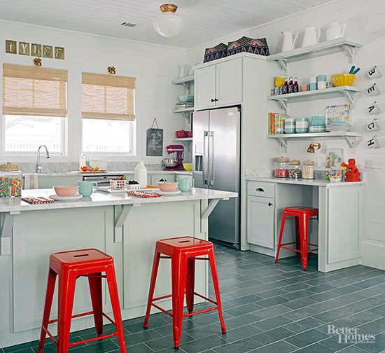 Group items in your kitchen by their function. In this kitchen, a stand mixer tucks in the corner by the refrigerator and shelves above house mixing bowls and baking necessities.