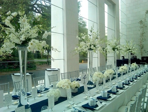 Tablescape perfection - navy, ivory flowers, simple, clean - love the varied heights, navy linens and accents