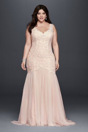 """It can't get more romantic than this trumpet gown with a gorgeous beaded venice lace bodice, scalloped lace tank sleeves, v-neckline and an alluring button back detail. All wrapped up into one alluring wedding dress. Galina Signature, exclusively for David's Bridal. 4"""" extra length dress. Also available in Regular, Petite,"""