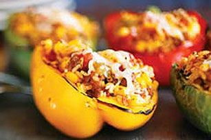 Kraft Tri Color Stuffed Peppers 2 cups frozen BOCA Ground Crumbles  1 pkg.  (10 oz.) frozen corn  1-1/2 cups TACO BELL® HOME ORIGINALS® Thick 'N Chunky Salsa  1-1/2 cups  cooked instant brown rice  1 cup KRAFT 2% Milk Shredded Colby & Monterey Jack Cheeses, divided  1   each large red, yellow and green pepper, cut lengthwise in half, seeds removed  1/2 cup water