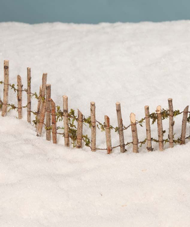 """An adorable little rustic fence for woodland Christmas villages, fairy gardens, gnome houses and putz house displays. - Wired sticks with greenery. - 6"""" tall x 17"""" long. - Bethany Lowe Christmas. - Im"""