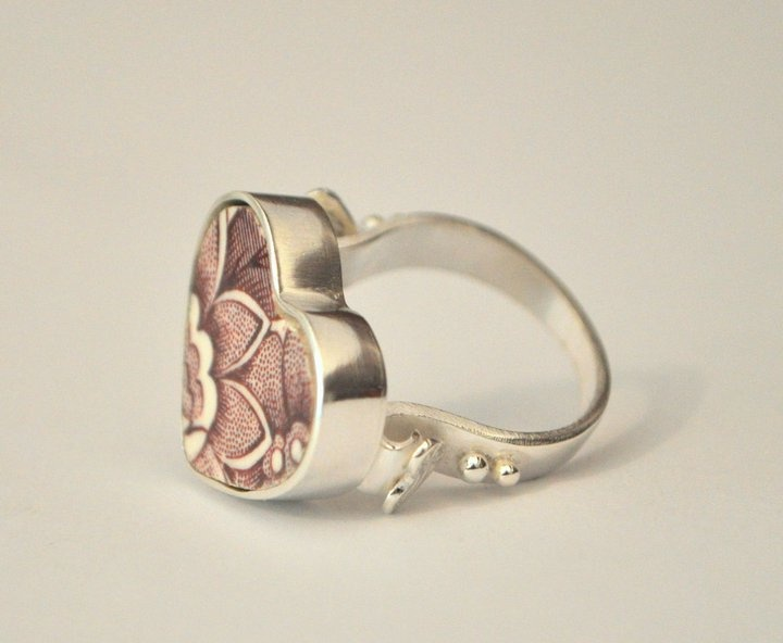 Vintage ceramic heart ring, set in sterling silver with embossed heart detail