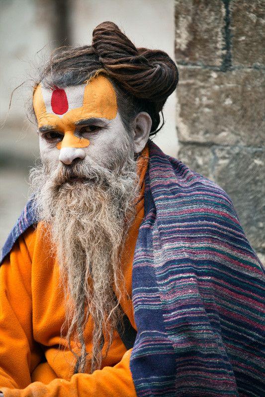 A Sadhu at Pashupatinath Temple, Kathmandu, Nepal. In Hinduism, a sādhu (good; good man, holy man) is a religious ascetic or holy person. Sādhus often wear saffron-colored clothing, symbolizing their sanyāsa (renunciation).