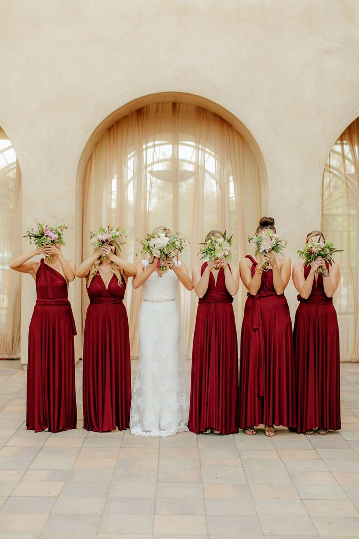 Versatile red bridesmaids dresses. So cute! View the full wedding here: http://thedailywedding.com/2016/05/29/stunning-serra-plaza-wedding-danielle-david/