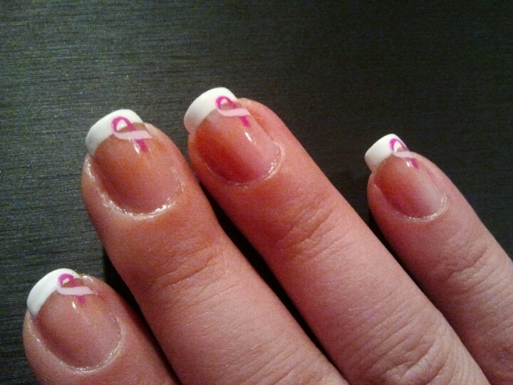 French manicure with breast cancer tattoo