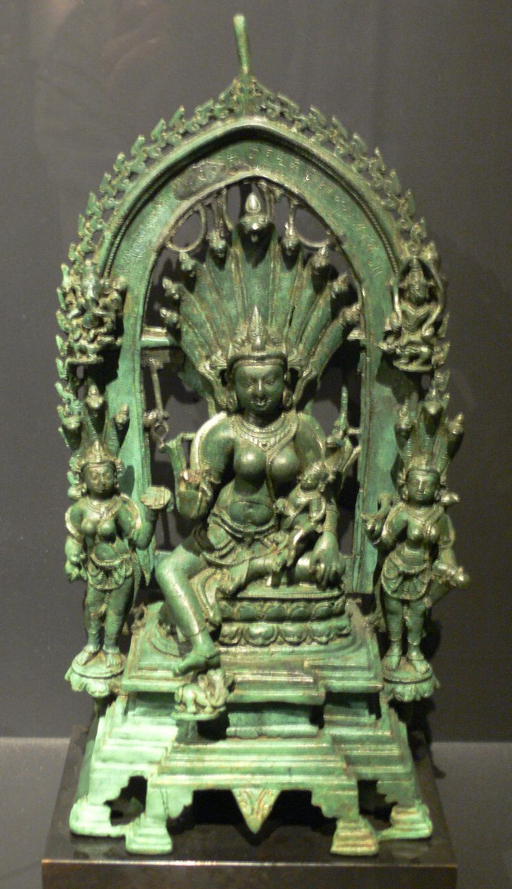 Manasa Devi with her son Astika on her lap. Next to her on the top arch: the elephant-headed god Ganesha, and the god of death Yama. Bronze casting, Bihar, eastern India, Pala style, 10th Century. Linden Museum, Stuttgart. High Resolution 3.2MB image.