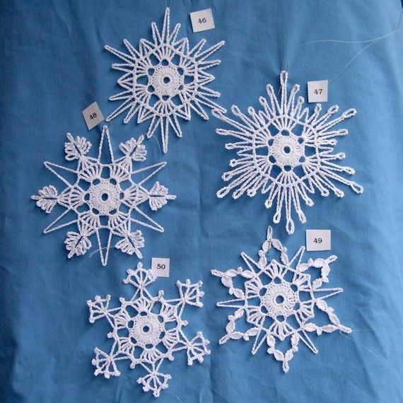 """Do you like to crochet? Do you like giving gifts to friends and family that you have made yourself? You will enjoy trying these patterns out. These beautiful snowflakes make great decorations and beautiful gifts.    What you will receive are original patterns, created by Peg, for 5 unique snowflakes. They will arrive via an email .pdf attachment. This """"e-book"""" includes a key for abbreviations, blocking pattern, and finishing instructions. Also included in the e-book are pictures of the…"""