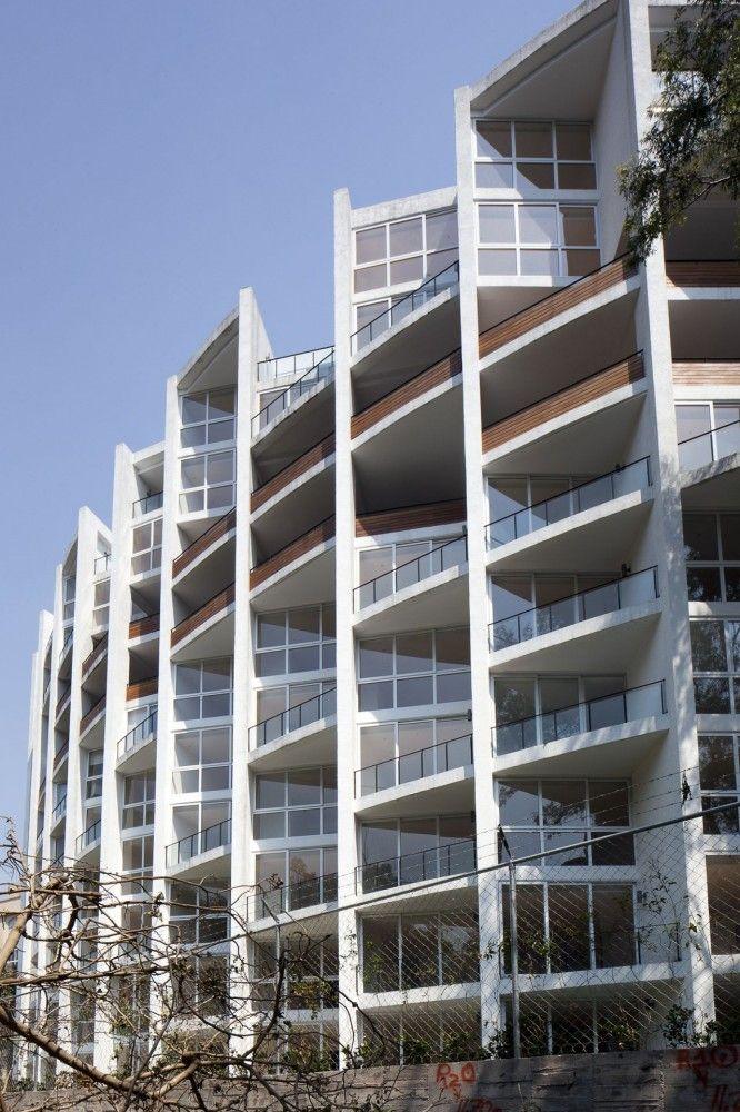 Teca Apartments / Lucio Muniain et al