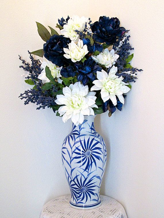 silk flower arrangement with large blue and white ceramic. Black Bedroom Furniture Sets. Home Design Ideas