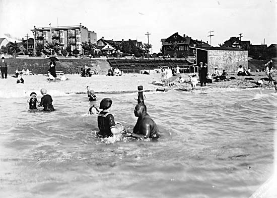 Joe Fortes instructs local swimmers, circa 1905.