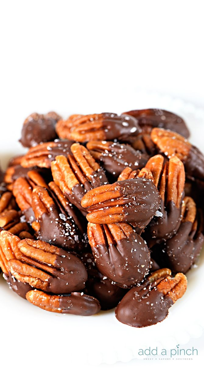 Chocolate Dipped Pecans make an easy, yet elegant treat perfect for entertaining and gifts! // addapinch.com