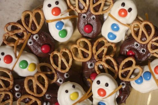 Reindeer and Snowman cookies (with Nutter Butters, chocolate, pretzels, and M)