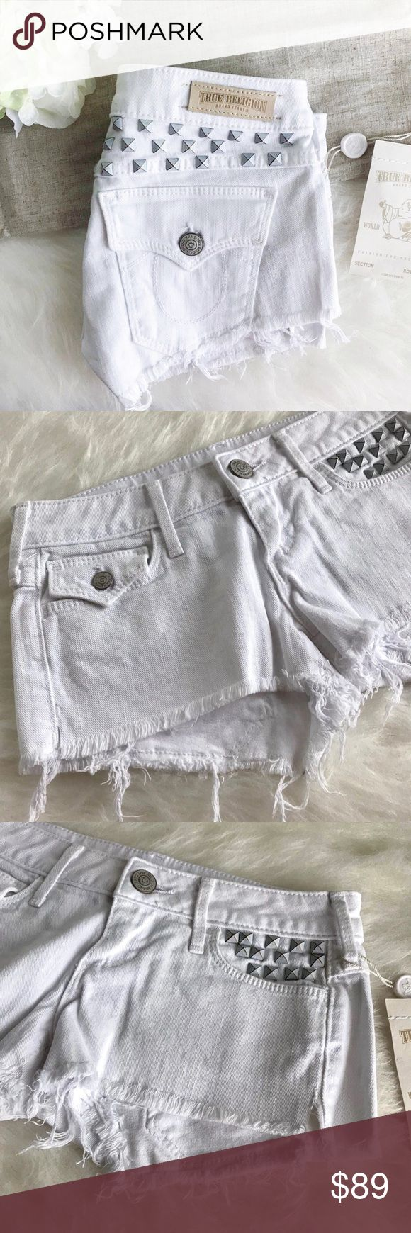 """true religion • embellished cutoff shorts True Religion studded white jean shorts  Super shortie shorts from True Religion. Frayed leg openings with slits on each leg. Stud embellishments on front pocket and across the top of the back. Small flap button pocket on right front. Color is optic white. It's not bright white. Color truest in last photo. Super cute!  size: 24 measurements:         •waist straight across: 13""""        •inseam: 2""""        •rise: 6"""" condition: new with tag True Religion…"""