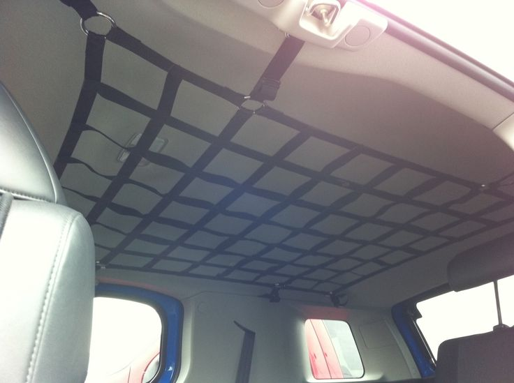 Interior Roof Cargo Net. Clever way to store things like small tents or screen rooms up and out of the way.
