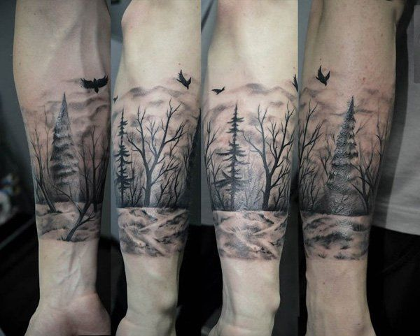 A striving tree in the midst of barren ones. It can show struggles in life but you can ultimately survive all of it. It's also one big picture around the arm so it's also a beautiful design in general.