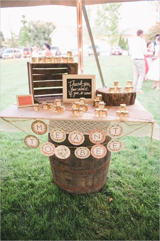 shabby chic wedding favor table with small jars of honey for guests to take home #weddingfavors #shabbychic #weddingchicks http://www.weddingchicks.com/2014/01/24/pinterest-inspired-vintage-wedding/