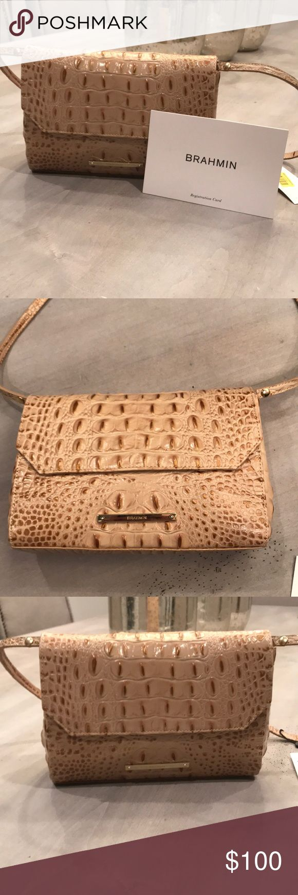Brahmin Purse Carina Champagne NWT The Carina features a removable shoulder strap that converts the handbag into a clutch. Complete with the signature organizational features Brahmin is known for. Featured in Champagne Melbourne, a neutral-hued crocodile embossed leather with subtle gold tipping. Brahmin Bags Shoulder Bags