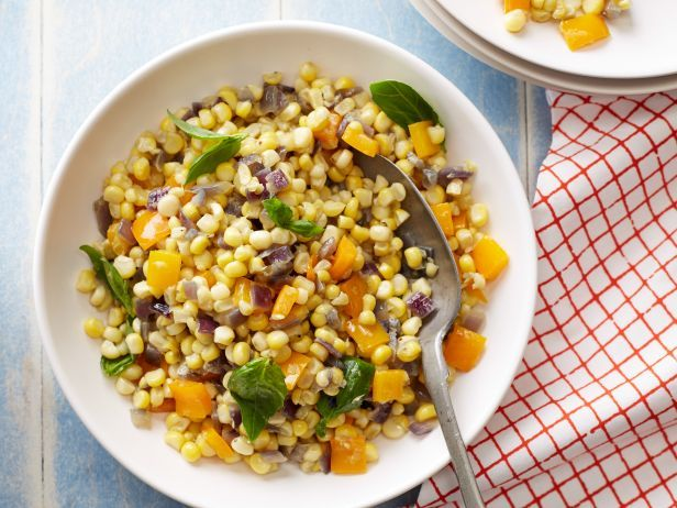 Recipe of the Day: Ina's Confetti Corn Ina slices the juicy kernels off the cob and cooks it with onion, bell peppers and a mix of fresh herbs. Pro tip: if the grill's already hot, bring your skillet outside to cook this easy taste of summer.